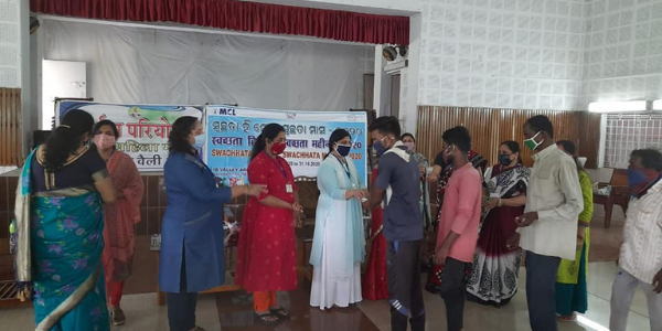 MCL distributed Soaps sanitizer and sanitary pads in CSR activities