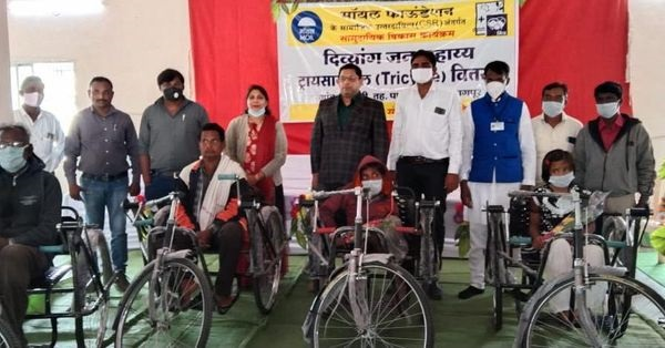 MOIL distributes tricycle to divyangs under CSR