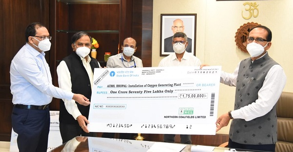 NCL CMD handed over Rs 10 Crore cheque to MP Government to fight against COVID