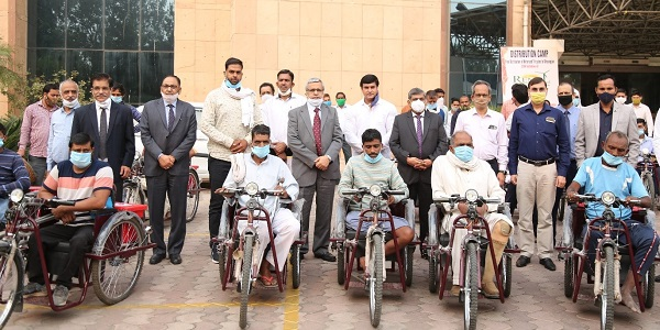 REMCL distributes motorised tricycles among divyangs