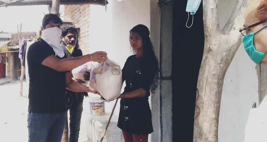CMPDI Employees distributes grocery bags of food items at door steps
