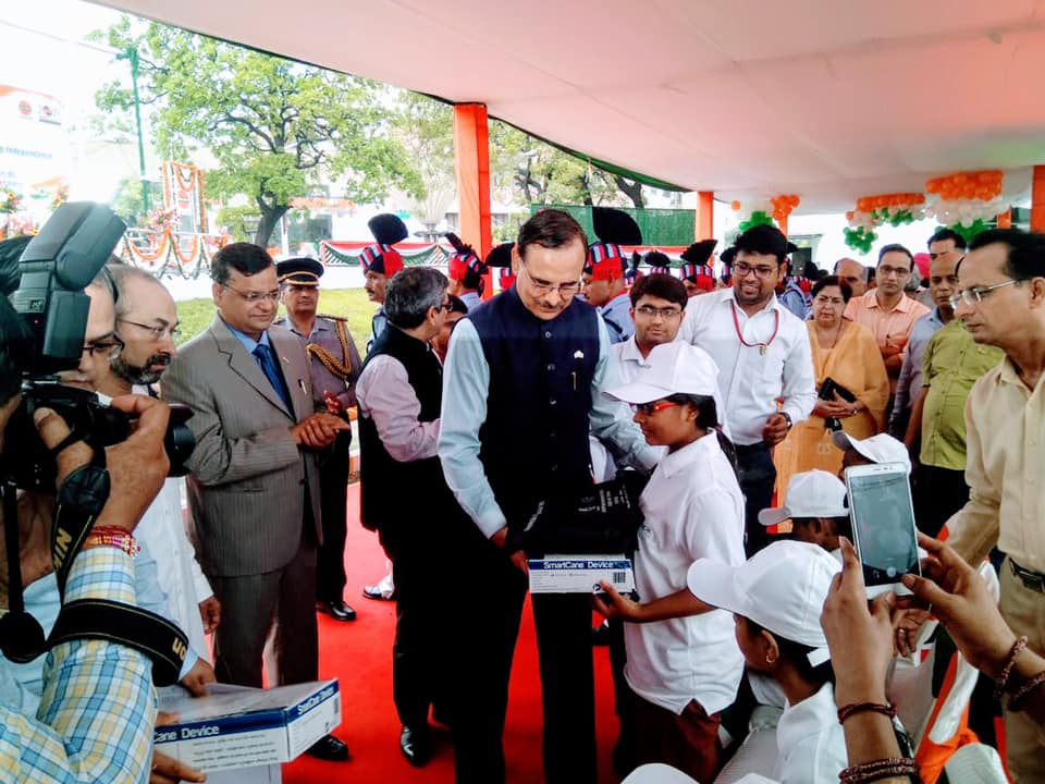 Shri Sanjiv Singh Chairman IndianOil and others are distributing smart canes and braille kits to students