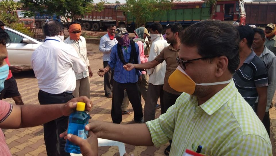 RCF distributes face masks and sanitizers to labours