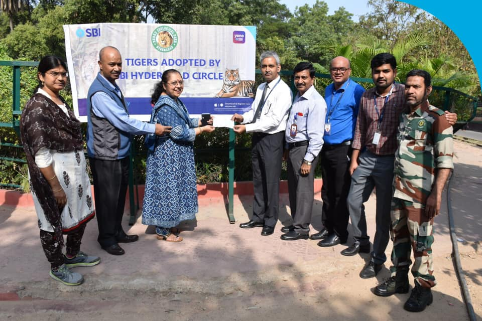 SBI hands over a cheque of 15 lacs to chief conservator of forests