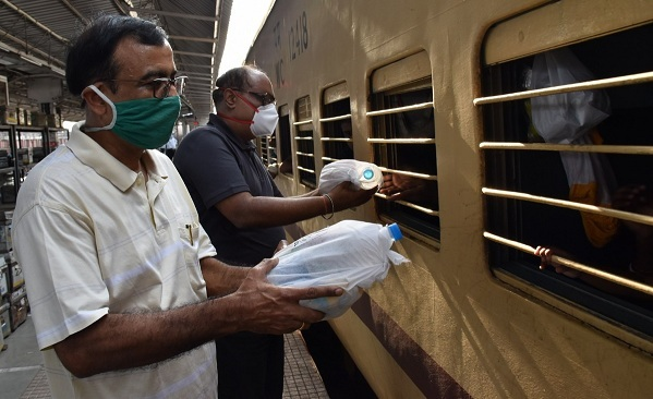 SECL distributes foods packets and water bottles to the passengers